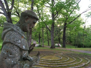 A St. Francis statue overlooks the labyrinth at Sacred Heart Monastery in Cullman, AL