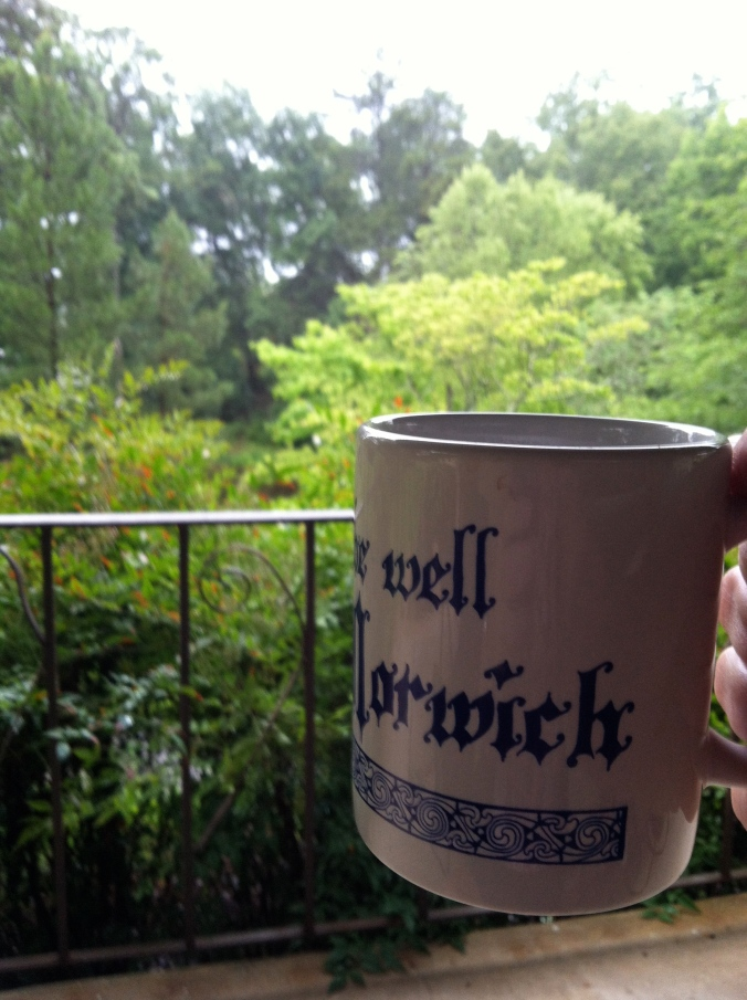 "Last day & coffee on the porch.  With a mug message from Julian of Norwich.  ""all shall be well.""  And it is."